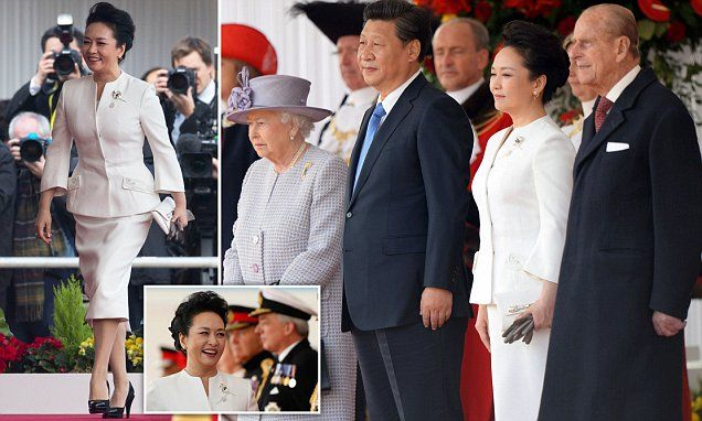 Chinese first lady exudes elegance in cool, white dress suit