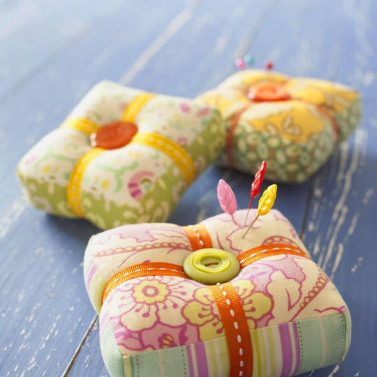 Bold fabrics, bright buttons, and colorful ribbon elevate a practical pincushion to new heights.