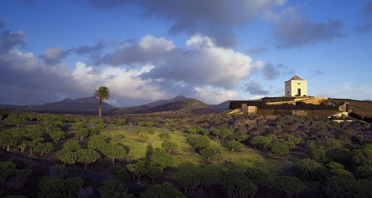 A small barn sits on a hilltop in the Yaiza area of southern Lanzarote, Canary Islands, Spain by SIME/eStock Photo © #Barn #Site #Scenery #Hills #Hilltop #Yaiza #Lanzarote #Canary_Islands #Spain