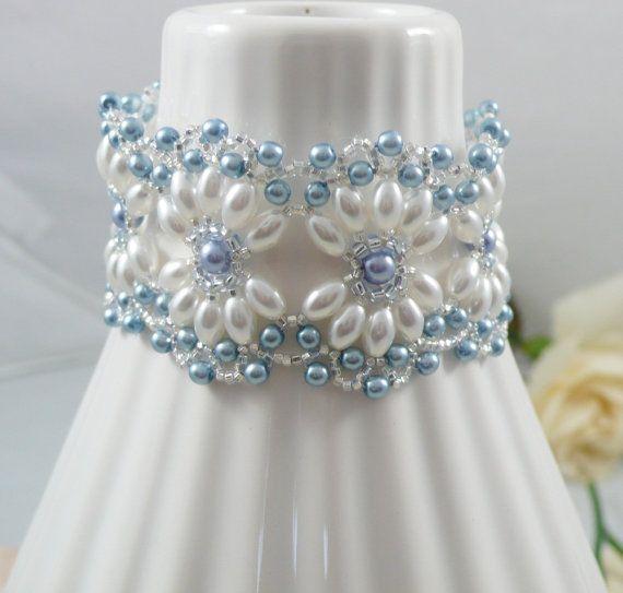 Bracciale in tessuto con perle ovali 42,06