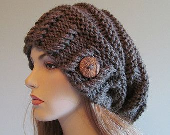This is a hand made knitted slouchy hat, or beanie that made of soft and chunky acrylic yarn in the Beige Flecks color. Its loose-fitted, cushiony and comfortable. Its a great accessory for fall, winter and spring. Thank you so much for stopping by, please check out my other hats and berets: http://www.etsy.com/shop/Lacywork?section_id=11219415   Have a great day.