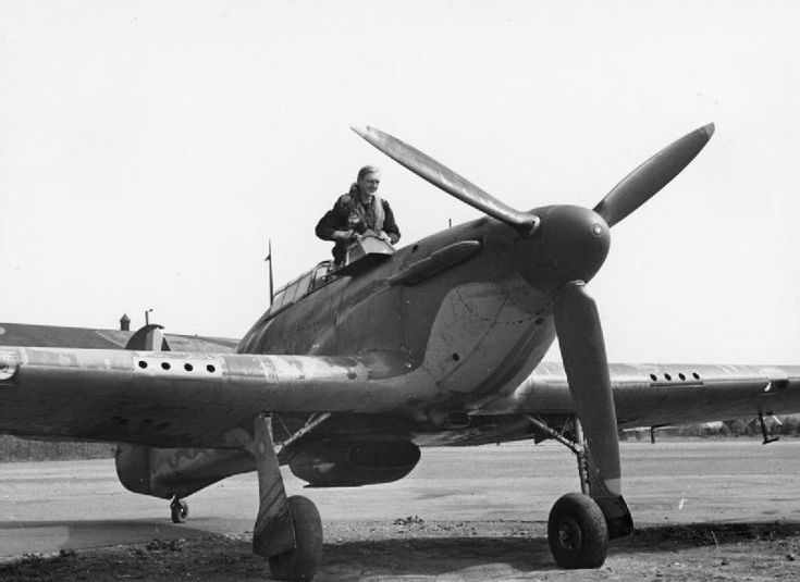 "F/Sgt Geoffrey ""Sammy"" Allard appears from the cockpit of Hurricane Mk I VY-H after returning from a sortie to RAF Castle Camps in July 1940. The 27-year-old pilot accounted for 25% of 44 enemy aircraft destroyed, 15 probables and 15 damaged claimed by No 85 Squadron RAF in August. Commissioned on 17 August and promoted to acting flight lieutenant on 8 September with command of A flight, he was awarded a Bar to his DFM on 13 September and the DFC on 8 October."