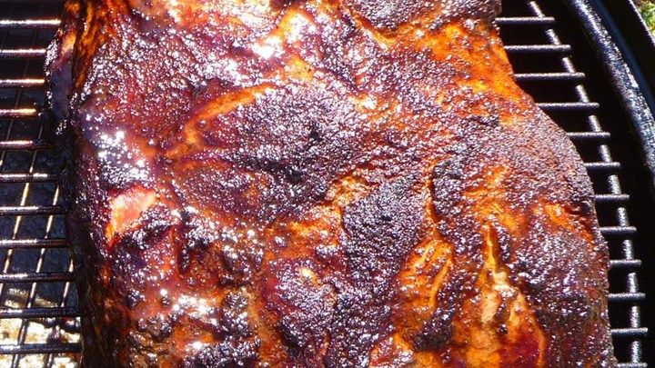 Pork shoulder is brined in a flavorful blend of apple cider and a classic blend of barbeque spices, then smoked until fork tender for a crowd-pleasing dinner.