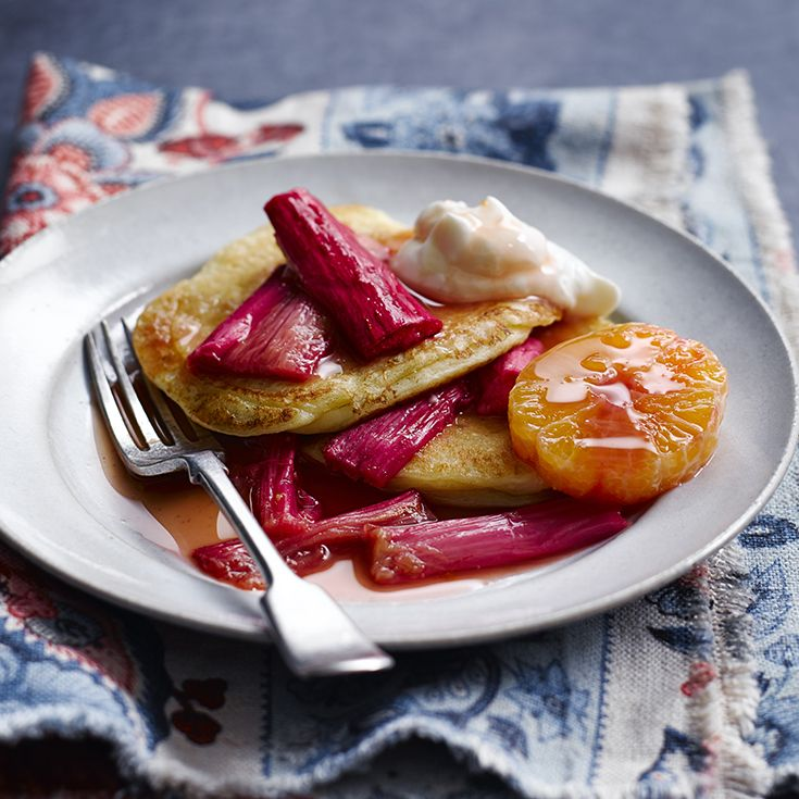These scrumptiously fluffy yogurt pancakes are made with low-fat Greek yogurt as a healthy alternative to buttermilk. Serve with a sticky rhubarb compote and en extra dollop of Greek yogurt.
