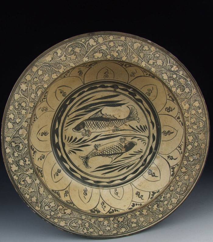 Cizhou ware black colored porcelain basin with fish pattern Yuan Dynasty, circa 1271–1368 AD.