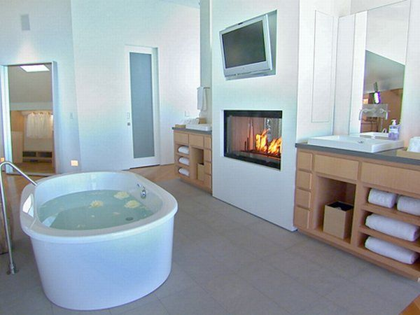 I Love and Hate the idea of a TV in the bathroom.  It would be nice to watch a show or movie while I'm getting all prune-y, but at the same time, it's not much of a quiet escape.  Jury's out on this feature.  HOWEVER, I'm 100% in love with the fireplace in the bathroom.  How have I lived without it?  How am I living without it?!?!