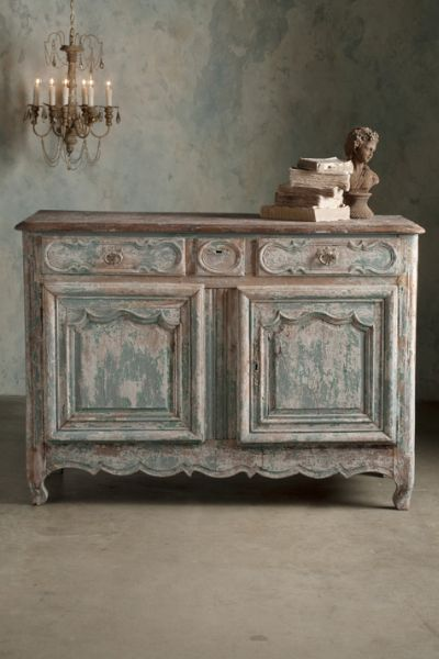 Lyon Sideboard Crafted circa 1780, this gorgeous two-door chest hails from the Lyon area of France. We were instantly impressed with its intricate hand-carved moldings, serpen
