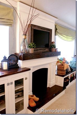 How we Built our Faux Mantel, step by step instructions to make your own faux fireplace, with a mantel that hides the TV cords (plus how to frame the TV) remodelaholic.com