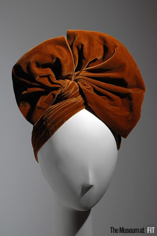 Lilly Dache, 1940, gold velvet hat. This hat is  coquettishly feminine . Museum at FIT New York.