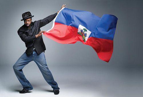 Wyclef Jean waving flag