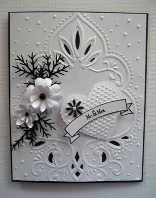 elegant black and white card... beautiful emboss and cut folder anchors the card with lovely flowers and textured heart...for a wedding...