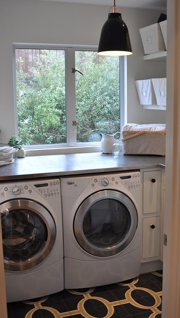 I like the idea of a countertop above the washer and dryer... Iike the white appliances too
