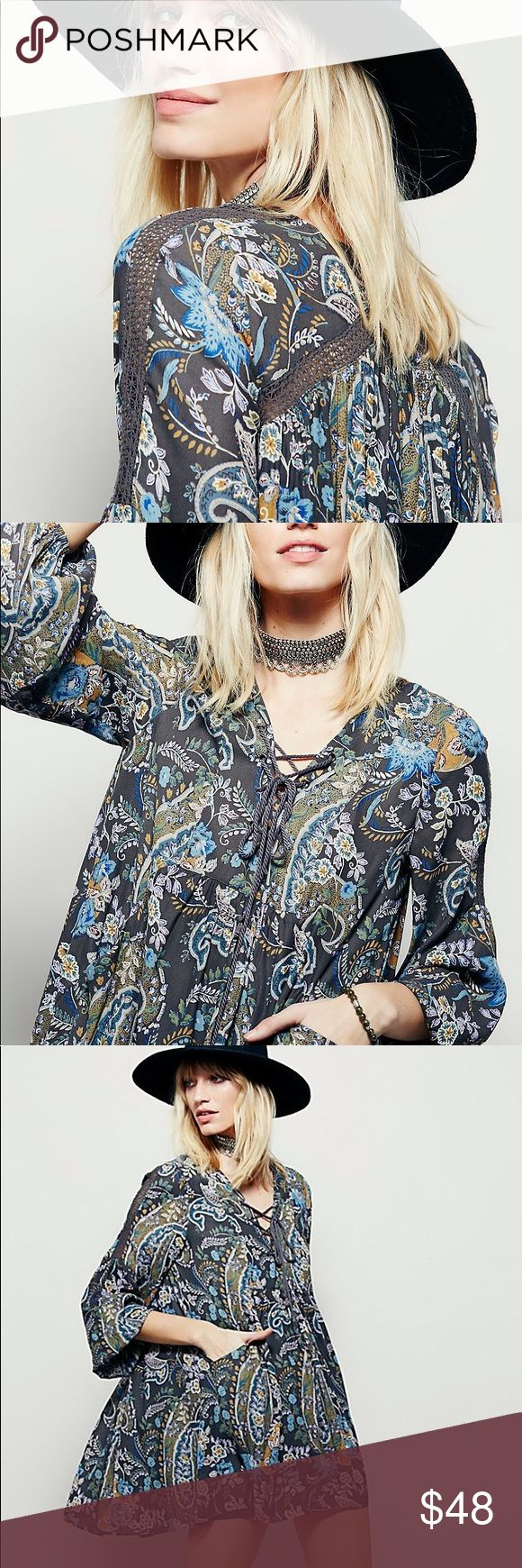 """Swingy Lace-Up Rain or Shine DRESS Paisley Multi BRAND NEW!! In a shapeless, swingy silhouette, this effortless printed mini dress is perfect for anything! Lace-up detailing on the neckline, crochet trim, and elastic band on the cuffs. Front pockets. Lined.🌟Similar style by Free People.🌟  S: Bust: 34.6""""/Length: 31.2"""" M: Bust: 36.2""""/Length: 31.8"""" L: Bust: 37.8""""/Length: 32.4""""  🌟🌟Item is Brand New, direct from the Manufacturer, & Sealed in Pkg. 🌟🌟 austin gal Dresses"""
