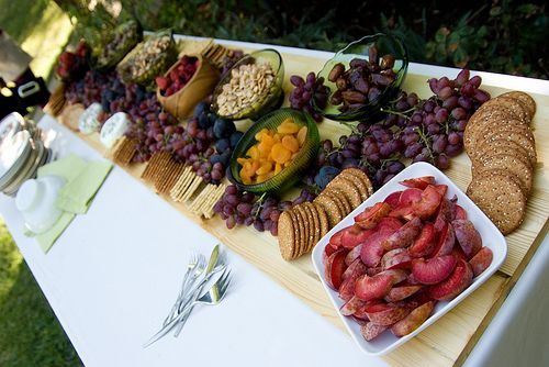 I like thid spread/layout...costco....a backyard wedding: cheese, crackers, grapes, nuts and olives spread. Alot of people suggested for inexpensive appetizers to go to costco and get various snacks, like crackers & cheese, or a few bowls of various nuts. Things to snack on, not too heavy and not too much.