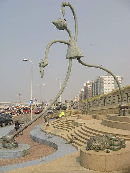 "Statue in Scheveningen of someone eating a ""raw"" herring in the traditional Dutch way."