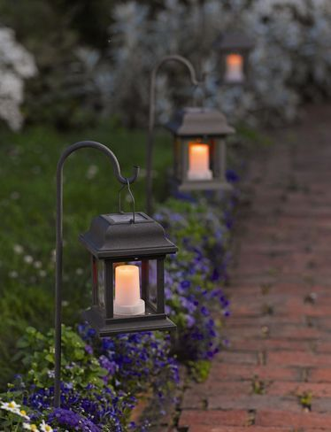 Elegant Using Solar Lanterns At The Border For Your Front Yard Design Is Nice And  Useful. It Also Save Your Electric Bill And Provide An Ambient Look At  Night.