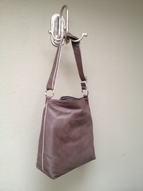 A warm taupe colored Cara bag