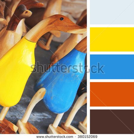 colorful wooden figurines of ducks,  color palette swatches.