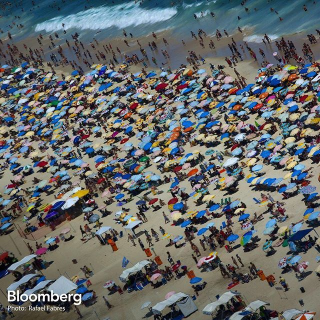 People relax on Ipanema Beach in Rio de Janeiro, Brazil, on Tuesday, Feb. 9, 2016. Officials from the tourism ministry estimate that tourists visiting for Carnival will add approximately $740 million to Rio's economy. #rio #ipanema #beach #brazil #summer #economics #BloombergPhotos