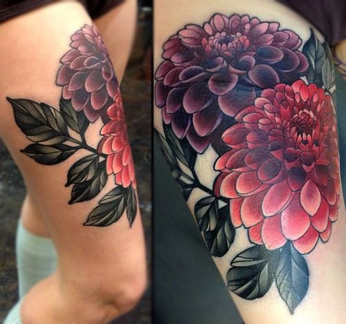 Purple and pink flowers tattoo, upper leg.