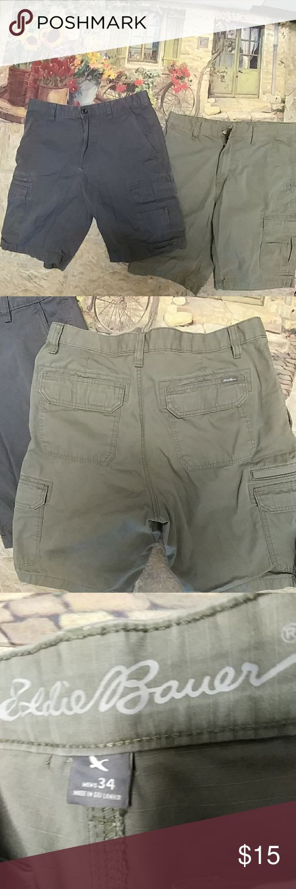 Pair great green Eddie Bauer men's cargo shorts 34 34 waist Side Pockets at waist velcro pockets down towards bottom and they Velcro and then there is a smaller pocket off of one of those packets.  Double pockets in the back of the shorts that velcro open and close these are button at the waist and ZIP down shorts with belt loops they are size 34 waist and also new without tags great deal for the right guy! One short is khaki green the other is gray. Eddie Bauer Shorts Cargo