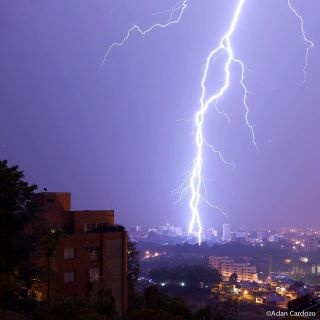 lightning from Pereira, Colombia about 1am, March 13, 2012. One of the scariest storms I've ever been in! This strike is literally right outside my apartment.