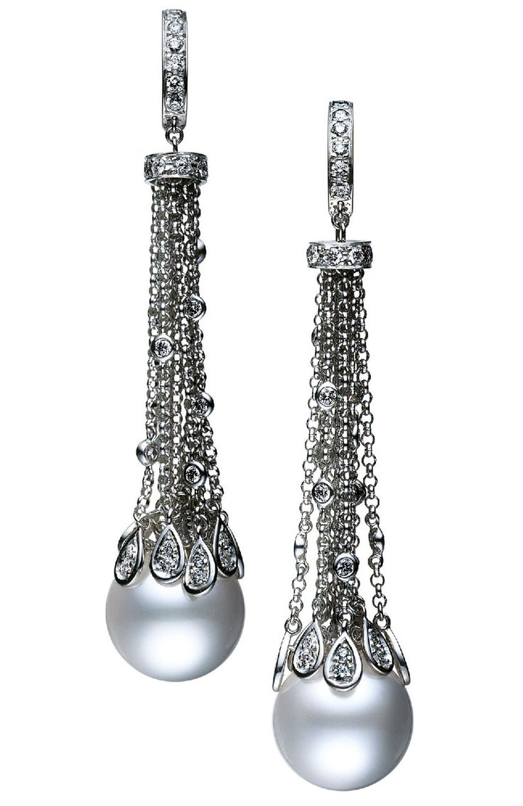 @Mikimoto Waterfall earrings, featuring droplets of diamonds, suspended from 18ct white gold chains, ending in two perfect cultured White South Sea pearls.