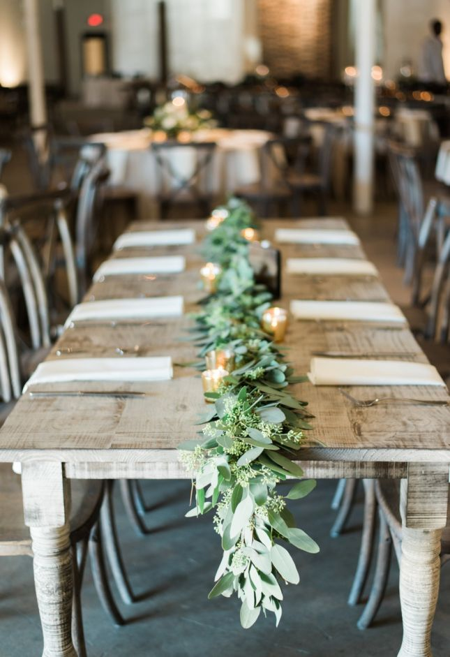 Garland is one of the most popular floral trends we've seen recently — and it's easy to see why! Greenery is more affordable than large floral displays, but still makes for stunning pictures. Drape it along a beautiful wooden farm table, to play up the earthy element
