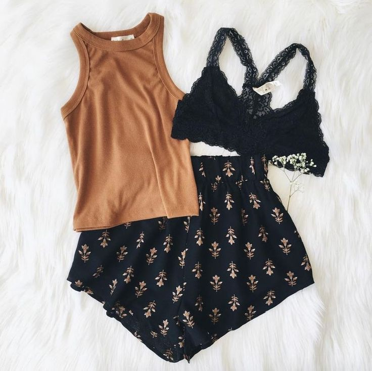 Black printed shorts, black lace bralette and rusted orange shirt