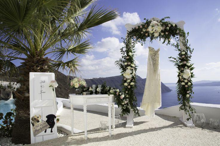 stunning wedding decoration beautiful arch white flowers greenery ceremony table wedding dress diamond rock venue architects villa santorini planners