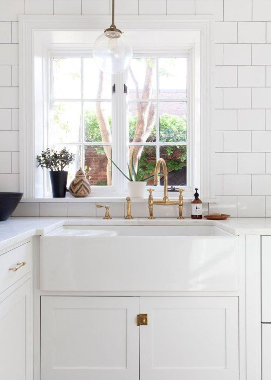 like the shape of the tile, the sink, the lighting fixture, and the brass fixtures/hardware