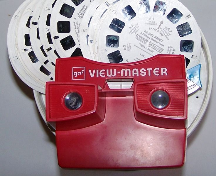 I loved my View Master, and I also had one that showed the pictures on the wall, like a slide projector.  LOVED  that thing!