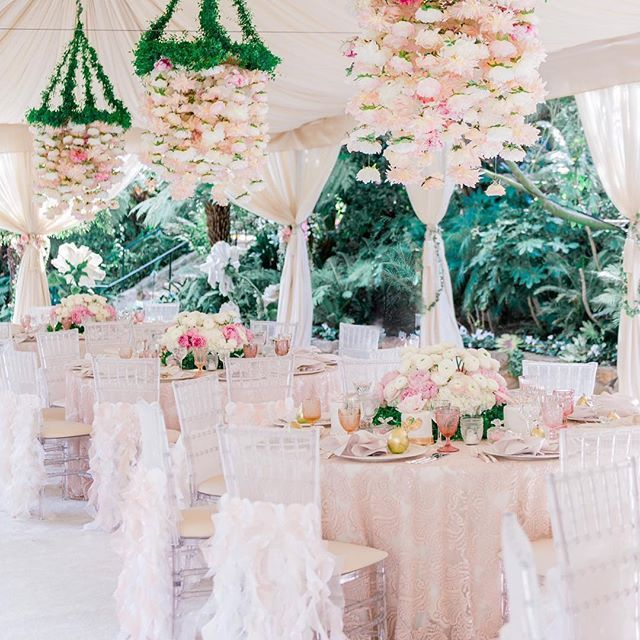 A #weddingtent filled with #ruffles #chaircovers and #flowerchandelier accent pieces is the icing on the cake to our #sweetandadorable posts this evening!  Event planning and Design: @alianaevents  Napkin rings and Chair Covers: @wildflowerlinen @youngsongmartin  Flowers: @celiosdesign  Rentals: @revelryeventdesign + @latavolalinen China: @classicparty  Venue: @mrcbeverlyhills