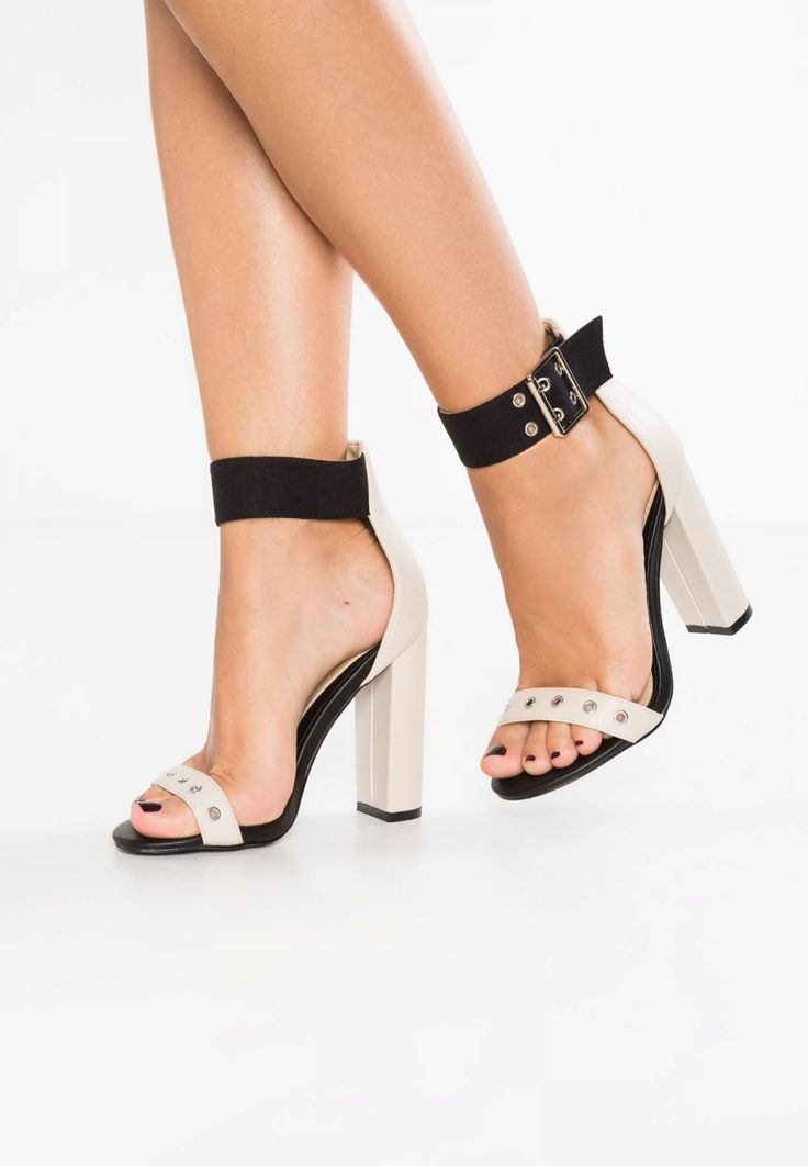 "Missguided. DOUBLE EYELET STRAP BLOCK HEEL - Sandals - nude. Sole:synthetics. heel height:4.0 "" (Size 4). Shoe tip:open. Heel type:block heel. Lining:imitation leather/ textile. detail:decorative studs. shoe fastener:buckle/bow. Fabric:Canvas,Synthetic leath..."