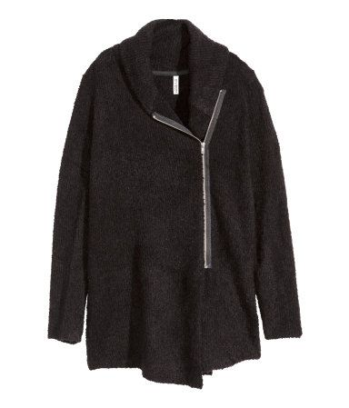 Black. Knit cardigan in bouclé yarn with wool content. Shawl collar, zip at one side, and long sleeves.