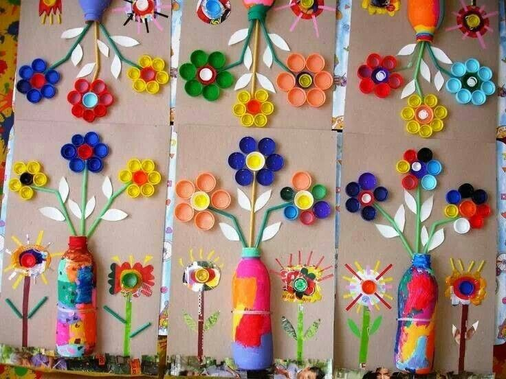 Recycled flower pics. Bottles as vases, lids as flowers, straws as stems.