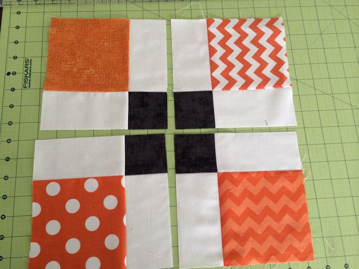 Kết quả hình ảnh cho 41 Patchwork Pumpkin quilt block and table runner tutorial halloween pumpkin patchwork pillow-001 A couple of years ago I made this simple patchwork pumpkin throw pillow. It's an easy project perfect for using up scraps. Here's a tutorial for this quilt block as well as some other patchwork pumpkin projects to make some quick scrappy Halloween decorations. (You can find a printable PDF version of this tutorial here for $2.) Quilt Block tutorial (13 1/2″ x 13 1/2″ finished) Fabric requirements: 16 orange squares 2 3/4″ x 2 3/4″ 17 black squares 2 3/4″ x 2 3/4″ 1 black square 1 1/2″ x 1 1/2″ 1 green square 2 3/4″ x 2 3/4″ 1 black strip 1 1/2″ x 14″ 1 black strip 1 3/4″ x 14″ To create the 16-patch pumpkin block begin by matching 4 black 2 3/4″ x 2 3/4″ squares with 4 orange 2 3/4″ x 2 3/4″ squares. Draw a diagonal line on the back of the orange squares and sew pairs together directly on the line. Trim 1/4″ away from the seam to create a 1/4″ seam allowance and press blocks open, pressing seams toward the black. Layout remaining orange 2 3/4″ squares with new half-square-triangle orange and black blocks into four rows of four. Sew together into four rows, pressing seams in alternating directions, every other row. Sew four rows together. To create green stem blocks, match-up a green 2 3/4″ block with a black 2 3/4″ block. Draw a diagonal line on the back of the green and sew directly on the line. Trim 1/4″ away and press block open. Match up a 1 1/2″ square in the corner of the green triangle. Draw a diagonal line and sew directly on the line. Trim 1/4″ away and press corner open. Repeat four times to make 5 stem blocks. To create stem row, use 3 other black 2 3/4″ squares and sew together into a row of four. Press seams all one direction. Attach stem rows to the 'top' of each of the 5 pumpkin blocks. Sew two rows of five 2 3/4″ x 2 3/4″ black squares. Sew to both sides of the pumpkin block. Add black 1 1/2″ x 14″ strip to the top of the block and black 1 3/4″ strip to the bottom of the block. To use as a pillow, use your favorite pillow finishing method and stuff with a 14″ x 14″ pillow form. Table Runner Tutorial 15 1/4″ x 57 1/2″ This look includes a variety of styles of pumpkin blocks to make it an even scrappier and unpredictable patch of pumpkins, good for showing off larger pumpkin prints as well. This row version could be easily replicated to make an entire quilt. Fabric Requirements for the table runner: 4-5 assorted orange and black fat quarters or assorted scraps Sashing 1/2 yard black print (I used the black spiders from Too Cute to Spook) Green solid: 1/8 yard Gingham Binding: 3/8 yard Backing: 1 1/8 yard Cutting From assorted oranges cut: 2 squares 9 1/2″ x 9 1/2″ 8 squares 5″ x 5″ 16 squares 2 3/4″ x 2 3/4″ From black sashing yardage cut: 5 strips 2 1/2″ x 42″. Sub cut 2 strips into 6 pieces 2 1/2″ x 11 3/4″. Use remaining strips to create two 2 1/2″ x 57 1/2″ border strips. From black scraps (including sashing print) cut: 40 squares 2 3/4″ x 2 3/4″ 5 squares 1 1/2″ x 1 1/2″ From green cut: 5 squares 2 3/4″ x 2 3/4″ From binding cut 4 strips 2 1/2″ x 42″