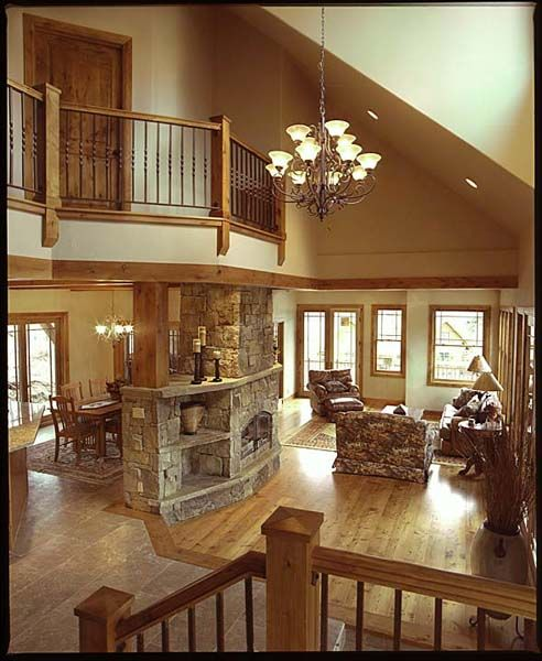 A pretty, open layout with balcony and stone fireplace.