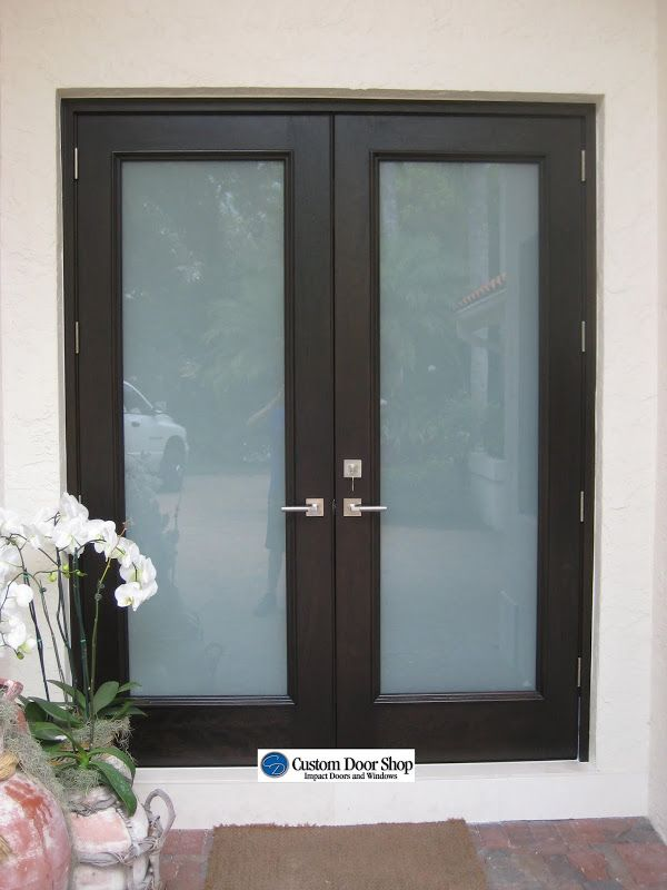 Contemporary and clean front door look. Double front doors made from mahogany wood and frosted glass for added privacy.
