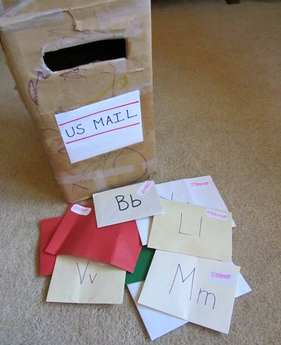 Make envelopes with upper and lowercase letter, fill each respective envelope with a photo of a family member or friend with that letter
