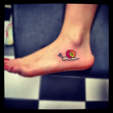 Snail tattoo. I like the placement, but not the design.
