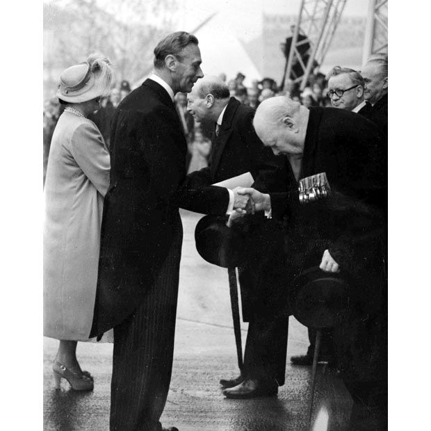 King George VI is greeted by Winston Churchill and Queen Elizabeth is greeted by Clemet Attlee at the South Bank Festival Exhibition 1951