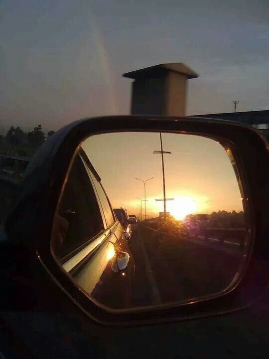 sunset in the rearview mirror @cikampekfreeway..