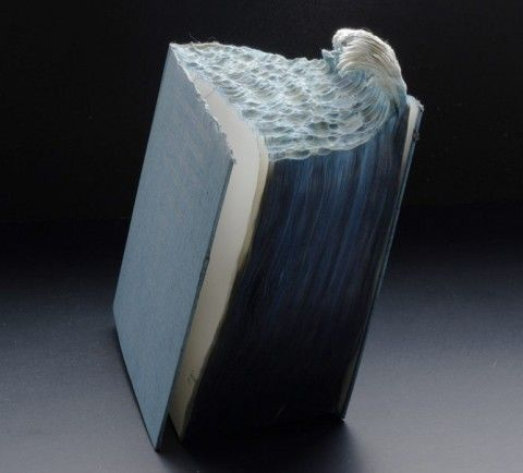 Book Sculpture by Guy Laramee.  this is crazy