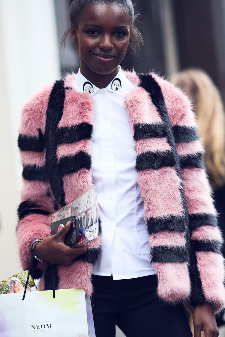 The Best Street Style At #LFW #SS17 Model Leomie Anderson wears the Gustav checked faux fur jacket over the Wonky appliqué cotton shirt #refinery29