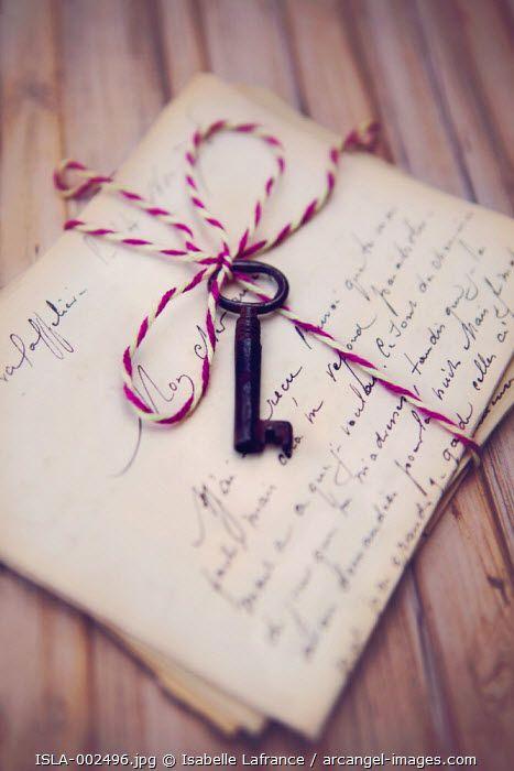 Skeleton key and old letters, Arcangel images, ©Isabelle Lafrance