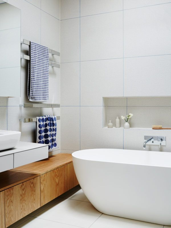 Bathroom details. Hand stamped spanish tiles add a textural detail. 'Heaps of storage was incorporated into the bathrooms to accommodate our teenage girl needs!' mentions Jo. Photo – Annette O'Brien. Production – Lucy Feagins / The Design Files.