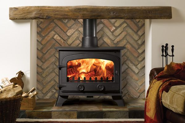 Multi-fuel stove and reclaimed oak mantle