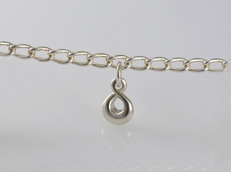 """Eternity Twist Charm,. NZ$45 Silver and  NZ$159 in 9ct yellow gold. Our """"Eternity"""" twist charm is beautifully crafted in sterling silver, 9ct yellow gold without a diamond or 9ct yellow gold with a diamond.. In NZ Maori, the single twist is known as the """"Pikorua"""". This charm is an elegant everyday piece and with its special meaning makes a perfect gift either on a chain or hanging from your charm bracelet. Jewellery made @jewelbeetle in Nelson, New Zealand."""