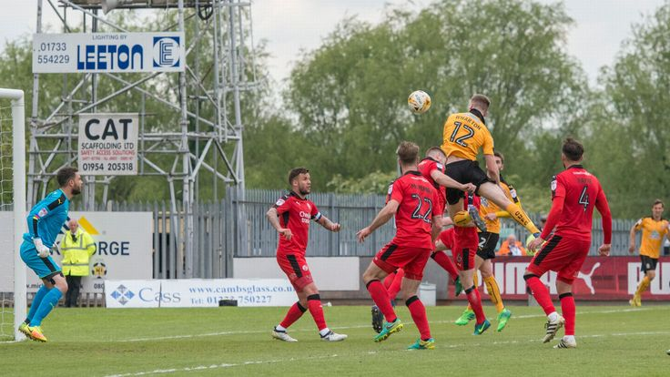 Scott Wharton heads in the opening goal for Cambridge United against Crawley Town